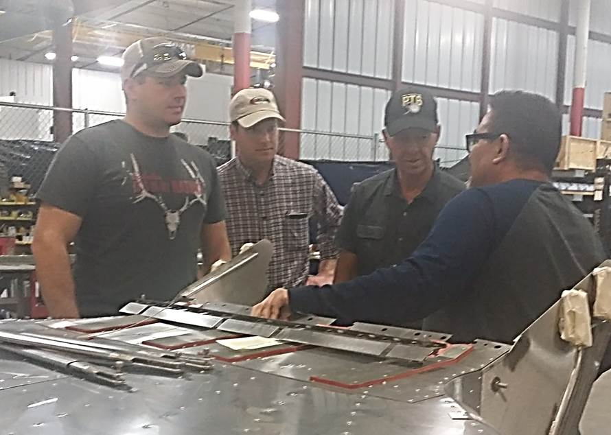 Brad Belyan, Jeff Wrighty and Rick MacNevin (from left) with Conair, tour the Transland plant with Roberto Rodriguez.